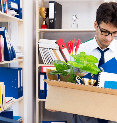 man packing in office