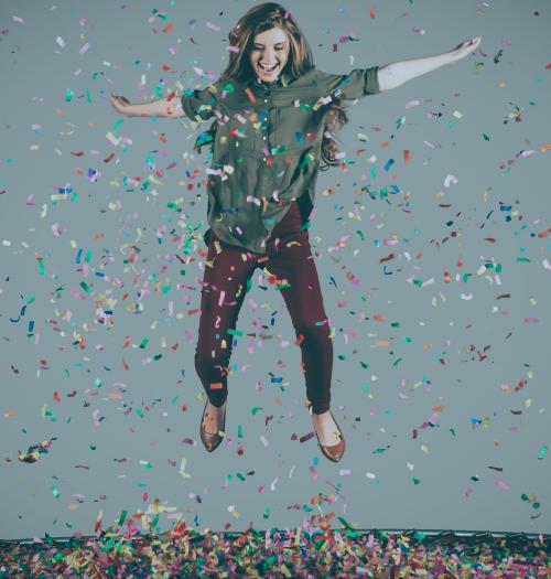 woman jumping in confetti