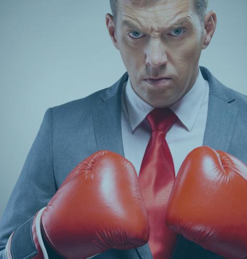 business man wearing boxing gloves